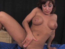Latina bangs herself and rides large dildo sofa